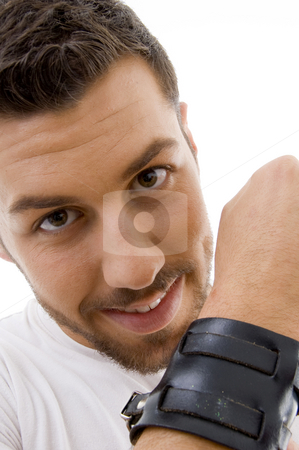 Close up of man with a band tied on hand  stock photo, Close up of man with a band tied on hand on an isolated background by Imagery Majestic