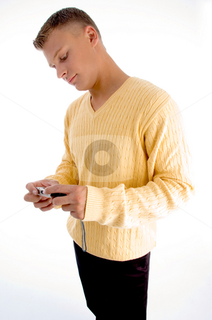 Side pose of standing male holding camera stock photo, Side pose of standing male holding camera against white background by Imagery Majestic
