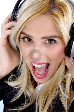 Front view of shouting woman enjoying music stock photo, Front view of shouting woman enjoying music and looking at camera by Imagery Majestic