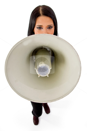 Top view of young female holding loudspeaker stock photo, Top view of young female holding loudspeaker against white background by Imagery Majestic