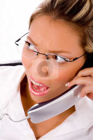 Close up of manager busy on phone stock photo, Close up of manager busy on phone on an isolated background by Imagery Majestic