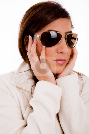 Fashion woman wearing sunglasses stock photo, Portrait of young female wearing sunglasses against white background by Imagery Majestic