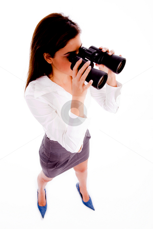 Businesswoman looking through binocular stock photo, Top view of businesswoman looking through binocular on an isolated white background by Imagery Majestic