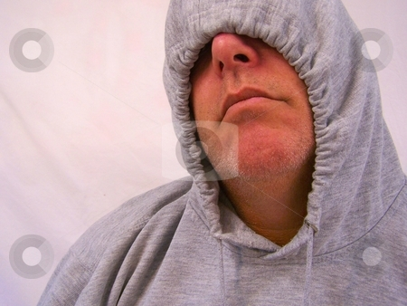 Man with hooded sweatshirt stock photo, Man with hooded sweatshirt over face and eyes. by Gregory Dean