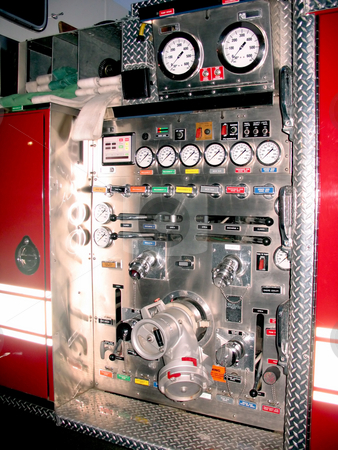 Fire truck detail stock photo, The side control panel of a modern fire engine. by Todd Arena