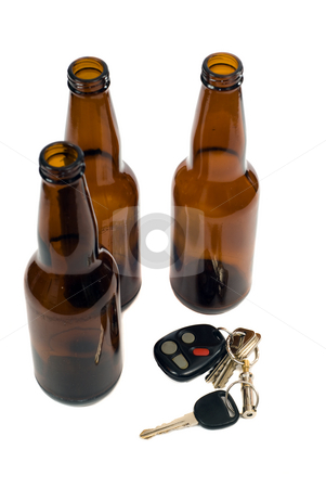 Drunk Driving Concept stock photo, Some car keys shot alongside some empty beer bottles, isolated against a white background by Richard Nelson