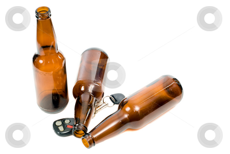 Drunk Driving stock photo, Concept image of drunk driving, with keys and empty beer bottles and the props by Richard Nelson