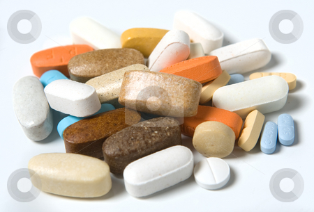 Pills stock photo, A group of various pills sit on a white background by Naturegraphica Stock