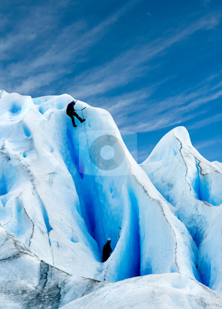 Climbing a glacier in patagonia. stock photo, Two men climbing a glacier in patagonia. by Pablo Caridad