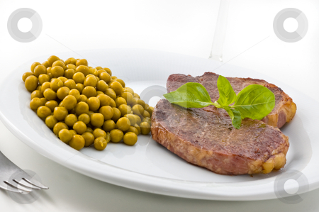 Dish of meat and peas with basil. stock photo, Dish of meat and peas with basil, studio shot. by Pablo Caridad