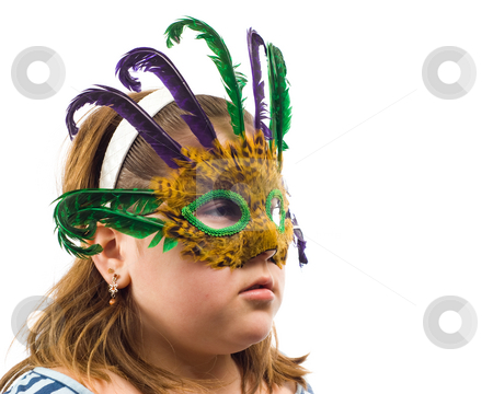 Masquerade Mask stock photo, Closeup of a young girl wearing a masquerade mask, isolated against a white background by Richard Nelson