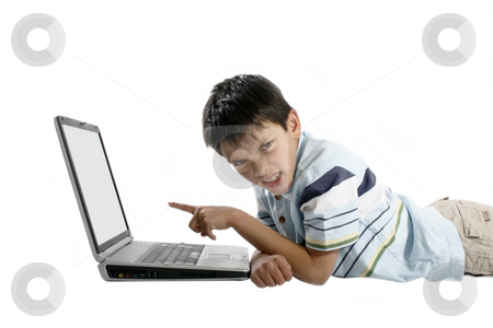 Boy using laptop stock photo, Young boy using laptop by Christopher Meder