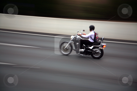Motor cycle blur stock photo, Slow shutter speed blur for motor cyclist by DAVID HILCHER