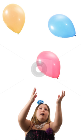 Flying Balloons stock photo, A young girl playing with some flying balloons, isolated against a white background by Richard Nelson