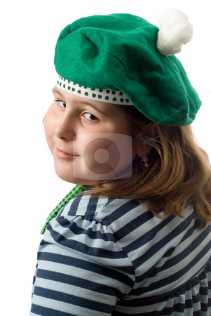 Irish Portrait stock photo, A young girl getting her portrait done while wearing a green hat, isolated against a white background by Richard Nelson