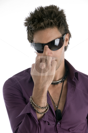 Handsome model with sunglasses stock photo, Handsome model with sunglasses with white background by Imagery Majestic