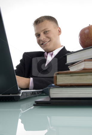 Smiling young executive stock photo, Smiling young executive on an isolated background by Imagery Majestic