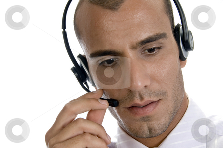 Young businessman with headphone stock photo, Young businessman with headphone with white background by Imagery Majestic