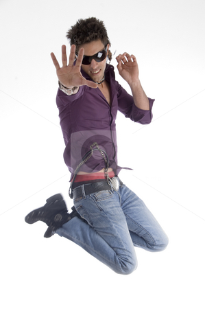 Jumping male dancer stock photo, White man showing cell phone against white background by Imagery Majestic