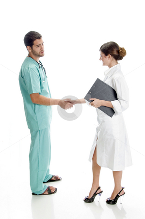 Medical professionals shaking hands stock photo, Medical professionals shaking hands against white background by Imagery Majestic