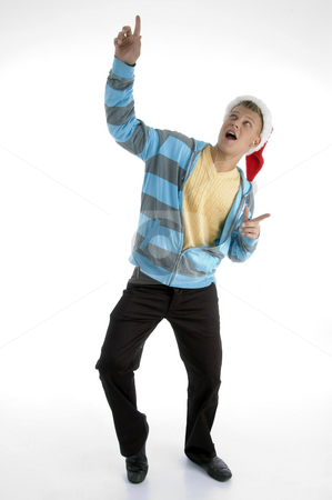 Pointing man with christmas hat stock photo, Pointing man with christmas hat against white background by Imagery Majestic