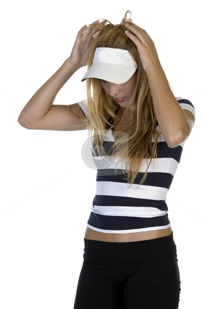 Smart lady adjusting her cap stock photo, Smart lady adjusting her cap on an isolated background by Imagery Majestic
