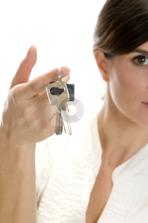 Lady with keys in her finger stock photo, Lady with keys in her finger with white background by Imagery Majestic