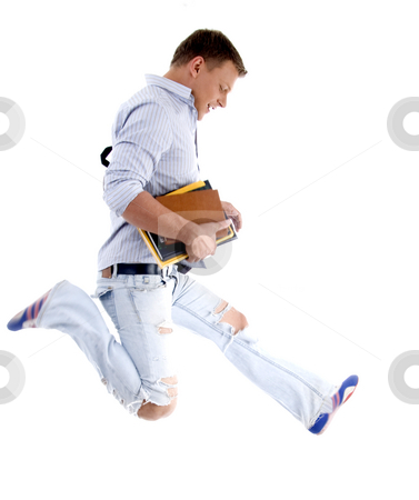 College student jumping high stock photo, College student jumping high isolated on white background by Imagery Majestic