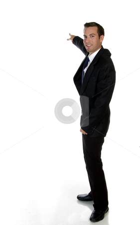 Smart businessman pointing sideways stock photo, Smart businessman pointing sideways on an isolated background by Imagery Majestic