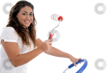 Young girl holding rolling brush stock photo, Young girl holding rolling brush on an isolated white background by Imagery Majestic