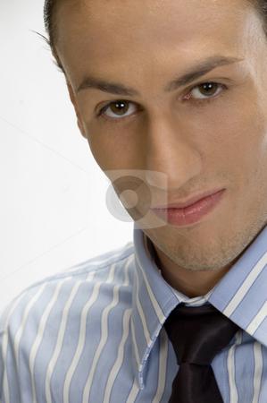 Young businessman posing stock photo, Close up young businessman posing by Imagery Majestic