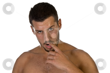 Young male looking with finger in his mouth stock photo, Young male looking with finger in his mouth on an isolated background by Imagery Majestic