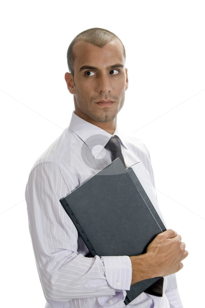 Handsome businessman holding files stock photo, Handsome businessman holding files and looking sideways by Imagery Majestic