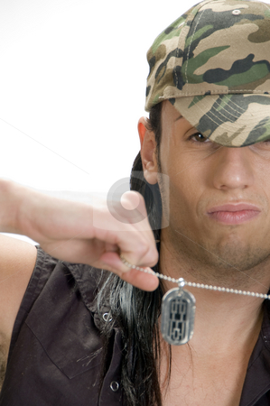 Male pulling his chain stock photo, Young male pulling his chain by Imagery Majestic