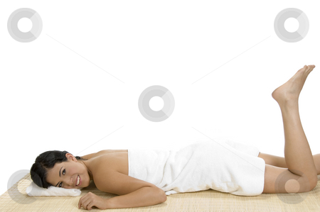 Pleased woman laying on bamboo mat stock photo, Pleased woman laying on bamboo mat by Imagery Majestic