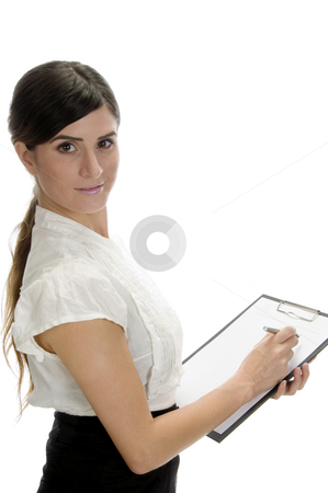 Smiling lady writing on paper stock photo, Smiling lady writing on paper on an isolated background by Imagery Majestic