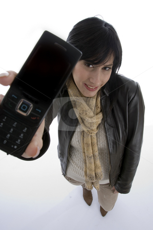 Happy woman showing cell phone stock photo, Happy woman showing cell phone with white background by Imagery Majestic