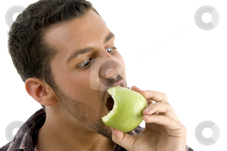 Man eating green apple   stock photo, Man eating green apple  on white background by Imagery Majestic