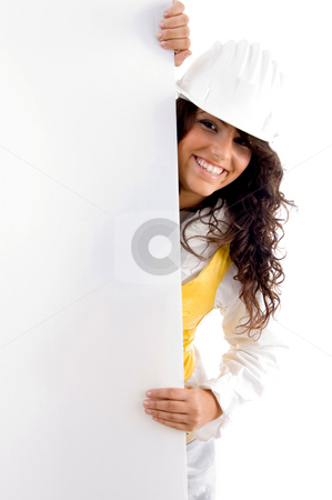Young architect with placard stock photo, Young architect with placard on an isolated white background by Imagery Majestic