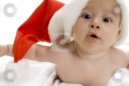 Young cute baby boy with red santa cap stock photo, Young cute smiling baby boy with red santa cap by Imagery Majestic