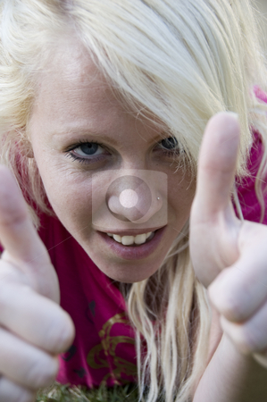 Close up of caucasian woman stock photo, Close up of caucasian woman wishing good luck by Imagery Majestic