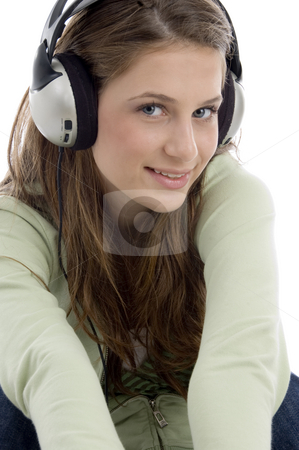 Close up of  pretty female in headset stock photo, Close up of  pretty female in headset on an isolated white background by Imagery Majestic