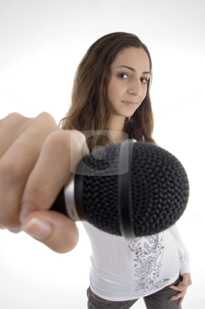 Young female holding microphone stock photo, Young female holding microphone on an isolated white background by Imagery Majestic