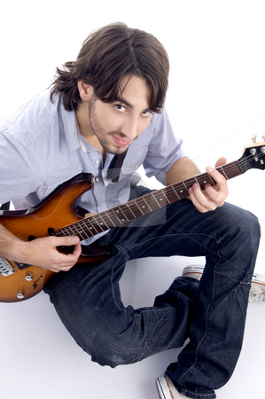 Young guy playing melody stock photo, Young guy playing melody with white background by Imagery Majestic