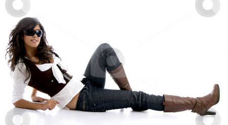 Female teenager resting on floor stock photo, Female teenager resting on floor against white background by Imagery Majestic