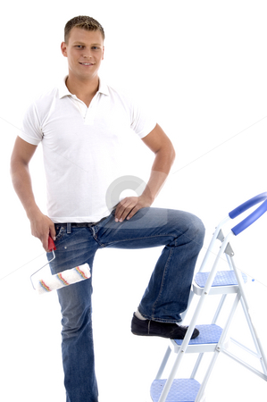 Handsome painter standing on ladder chair stock photo, Handsome painter standing on ladder chair isolated on white background by Imagery Majestic