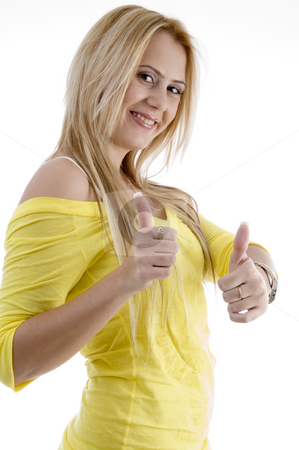 Smiling woman showing good luck sign stock photo, Smiling woman showing good luck sign on an isolated background by Imagery Majestic