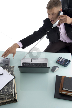 Sitting businessman busy on the phone stock photo, Sitting businessman busy on the phone  against white background by Imagery Majestic