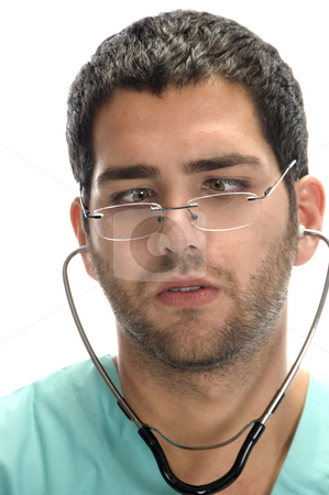 Doctor with stethoscope in his ears looking squint stock photo, Doctor with stethoscope in his ears looking squint against white background by Imagery Majestic