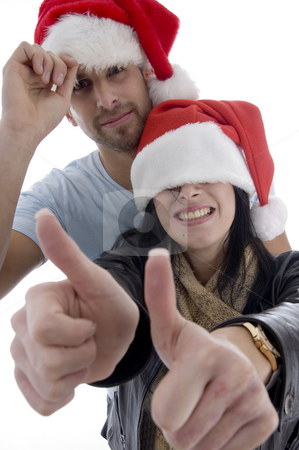 Young couple with chritsmas hat  stock photo, Young couple with chritsmas hat on an isolated white backgound by Imagery Majestic